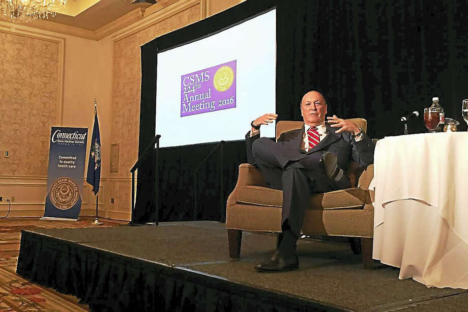 Journalist and bestselling author Steven Brill talks about the Affordable Care Act during the Connecticut State Medical Society's 224th annual meeting at the Omni New Haven Hotel at Yale on Wednesday. Photo: Esteban L. Hernandez — New Haven Register