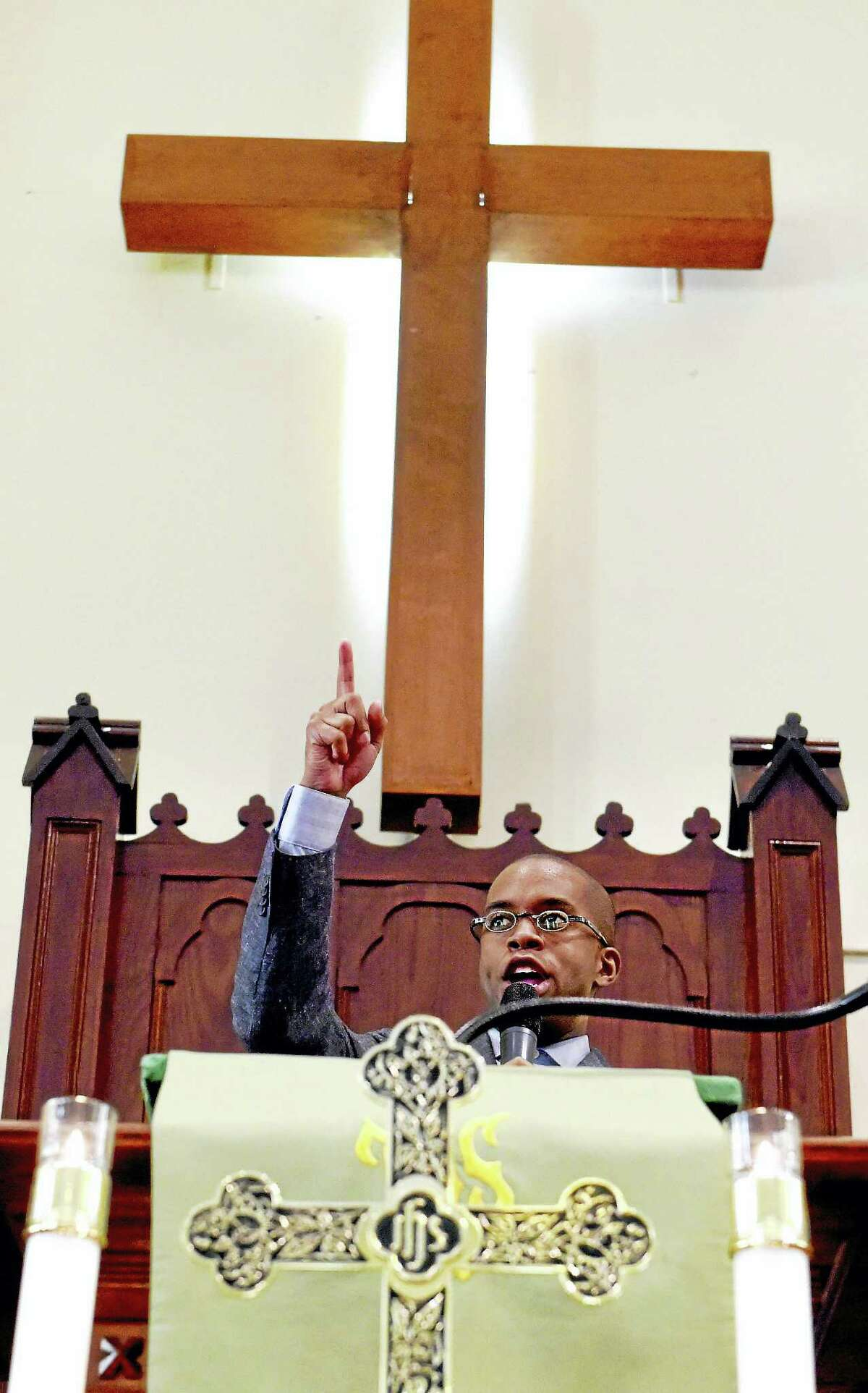 Pastor Eldren D. Morrison of the Varick Memorial A.M.E. Zion Church in New Haven delivers his last sermon at the church Sunday afternoon.
