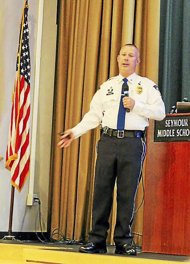 Seymour Deputy Police Chief Paul Satkowski addresses small crowd at Emergency Services Forum at Seymour Middle School Wednesday night. Photo: Jean Falbo-Sosnovich — New Haven Register