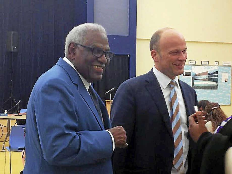 Interim Superintendent of Schools Reginald Mayo, left, with outgoing Superintendent of Schools Garth Harries. Photo: Brian Zahn — New Haven Register