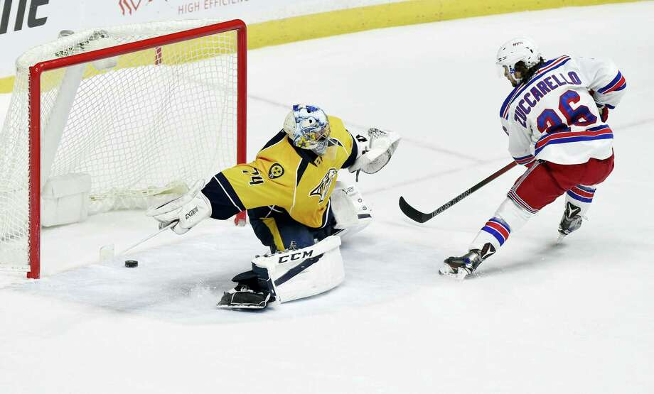 New York Rangers right wing Mats Zuccarello (36), of Norway, seals a victory with a goal against Nashville Predators goalie Juuse Saros (74), of Finland, during the shootout period of an NHL hockey game Saturday, Dec. 17, 2016 in Nashville, Tenn. Photo: AP Photo/Sanford Myers   / Sanford Myers
