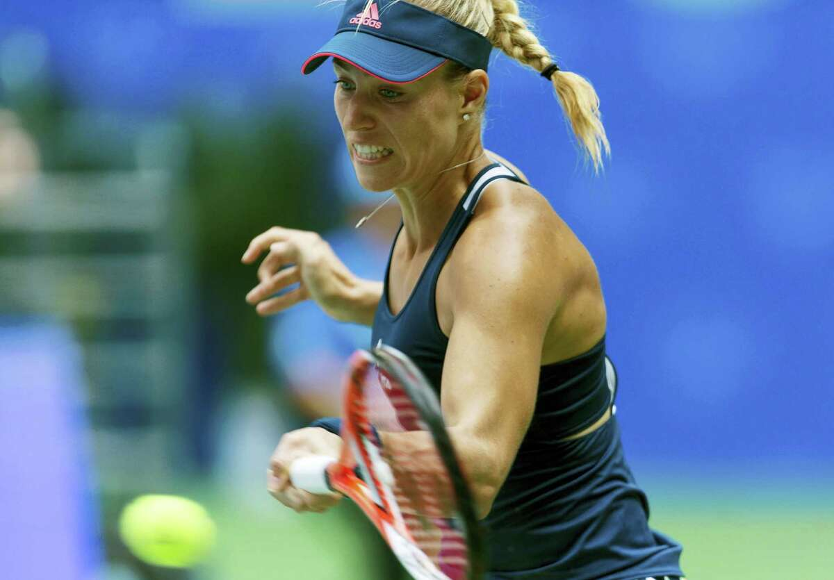 Angelique Kerber of Germany hits a return while playing against Kristina Mladenovic of France during the WTA Wuhan Open in Wuhan in central China's Hubei province on Sept. 27, 2016.