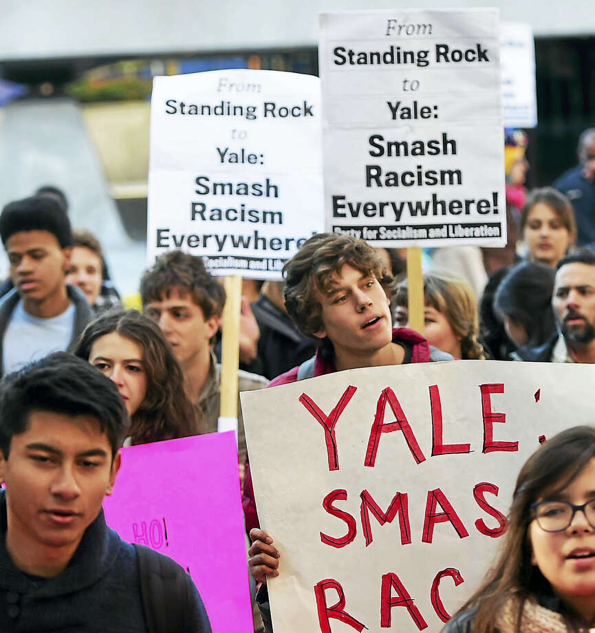 Protesters at Beinecke Plaza in front of Woodbridge Hall Friday call for renaming Yale University's Calhoun College. Photo: Peter Hvizdak — New Haven Register   / ©2016 Peter Hvizdak