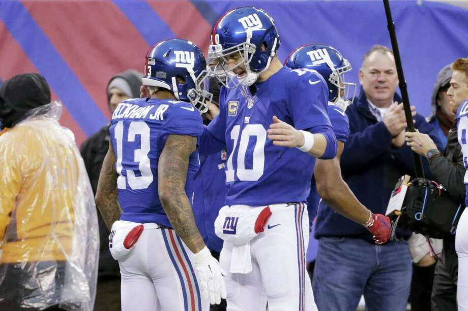 Giants quarterback Eli Manning, right, and Odell Beckham celebrate after they connected for a touchdown during the second half Sunday against the Lions. Photo: Seth Wenig — The Associated Press   / AP