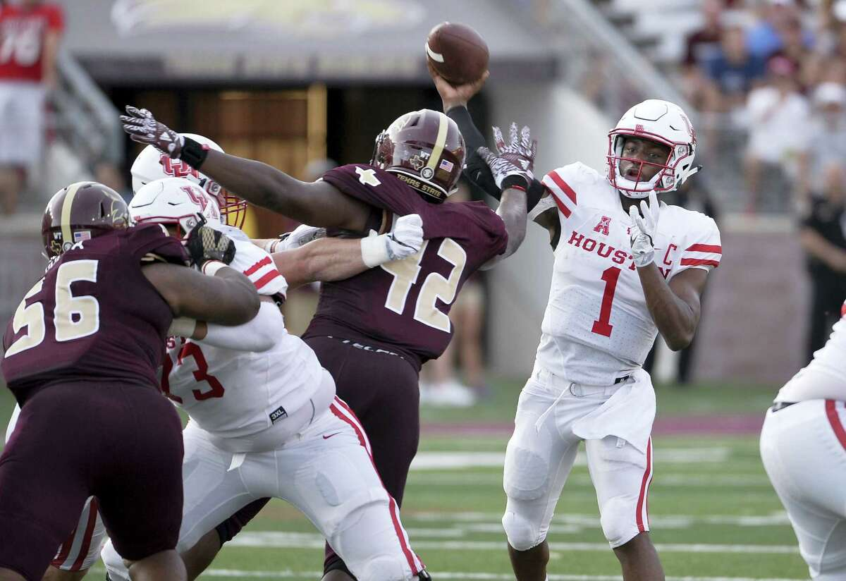 Houston quarterback Greg Ward, Jr., throws the ball over Texas State defenders during the first half of an NCAA college football game, Saturday, Sept. 24, 2016, in San Marcos, Texas. (AP Photo/Darren Abate)