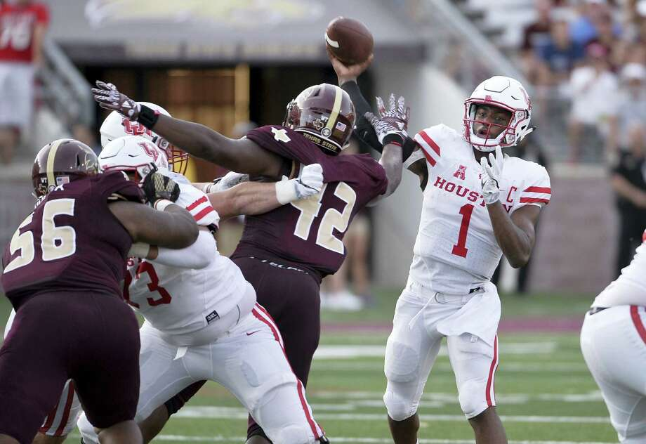 Houston quarterback Greg Ward, Jr., throws the ball over Texas State defenders during the first half of an NCAA college football game, Saturday, Sept. 24, 2016, in San Marcos, Texas. (AP Photo/Darren Abate) Photo: AP / FR115 AP
