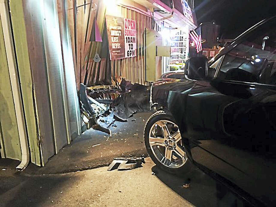Branford police and fire departments respond after a pickup truck driver crashes into a building at 317 East Main St. on Monday, Sept. 26, 2016. Photo: Photo Courtesy Of Branford Police Department