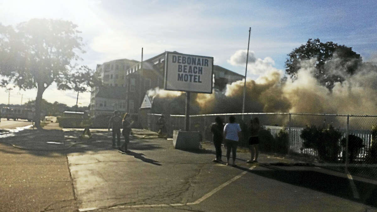 The former Debonair Beach Motel caught on fire Monday.