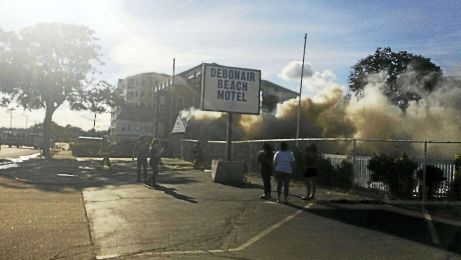 The former Debonair Beach Motel caught on fire Monday. Photo: Wes Duplantier — New Haven Register