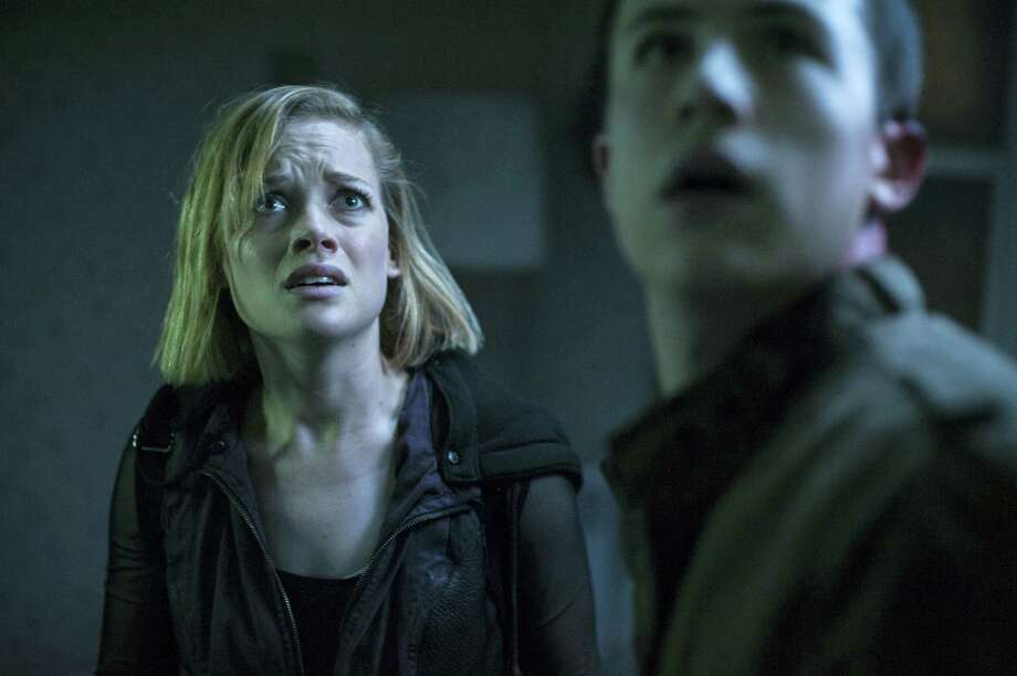 """This undated file image released by Sony Pictures shows Jane Levy, left, and Dylan Minnette in a scene from """"Dont Breathe."""" According to studio estimateson  Aug. 28, 2016, audiences turned out in droves for the late summer thriller, which brought in $26.1 million. Photo: Gordon Timpen/Sony/Screen Gems Via AP, File   / © 2016 CTMG, Inc. All rights reserved.**ALL IMAGES ARE PROPERTY OF SONY PICTURES ENTERTAINMENT INC. FOR PROMOTIONAL USE ONLY. S"""