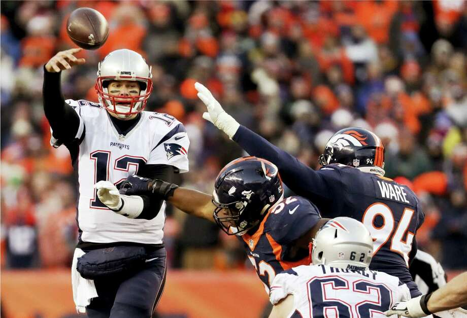 Patriots quarterback Tom Brady throws under pressure against the Broncos on Sunday. Photo: Jack Dempsey — The Associated Press   / FR42408 AP