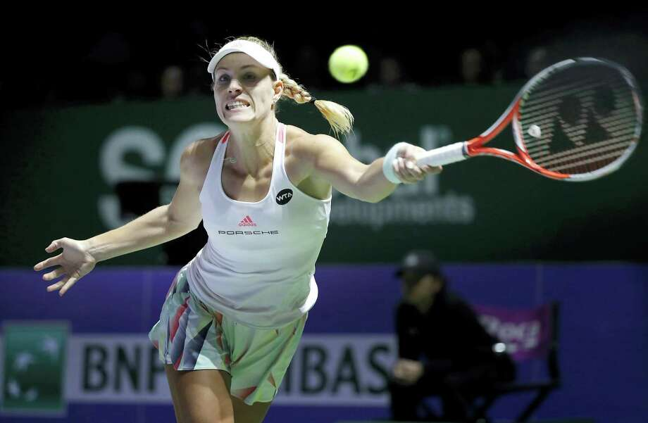Angelique Kerber of Germany make a forehand return against Madison Keys of the United States during their singles match at the WTA tennis tournament in Singapore on Oct. 27, 2016. Photo: AP Photo/Wong Maye-E   / Copyright 2016 The Associated Press. All rights reserved.