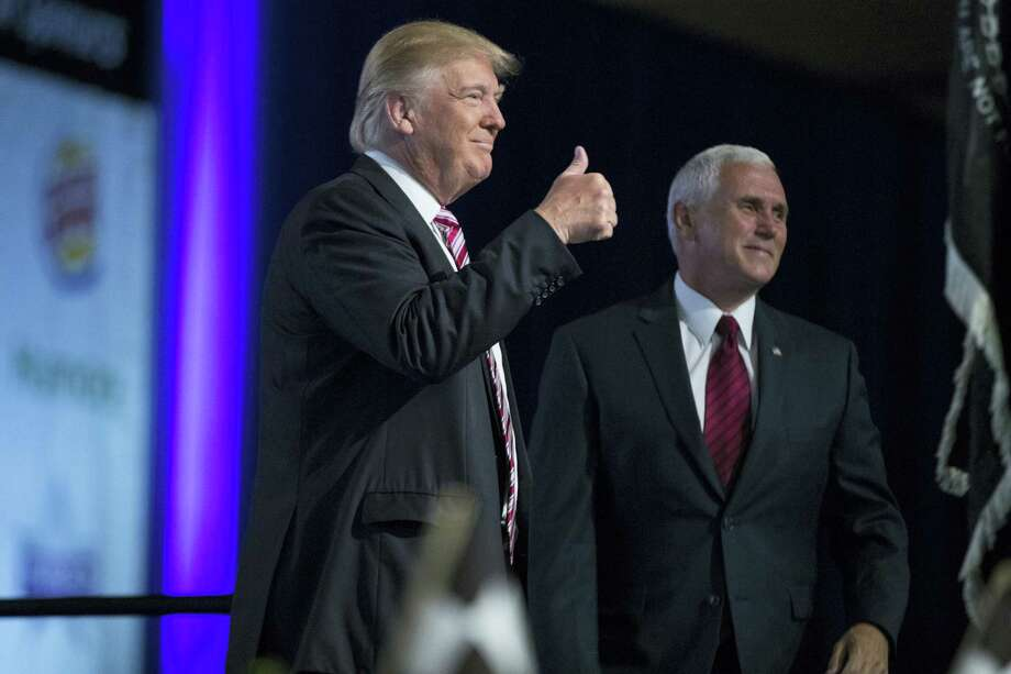 Republican presidential candidate Donald Trump and his running mate, Indiana Gov. Mike Pence, arrive for the Veterans of Foreign Wars convention Tuesday in Charlotte, North Carolina. Photo: THE ASSOCIATED PRESS   / Copyright 2016 The Associated Press. All rights reserved. This material may not be published, broadcast, rewritten or redistribu