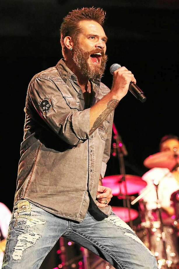Singer Bo Bice is shown performing on stage along with Blood, Sweat & Tears during the band's concert at the Connecticut Convention Center in Hartford on July 24th. Also included in the double bill show was Jefferson Starship. Photo: Photo By John Atashian For Digital First Media/File