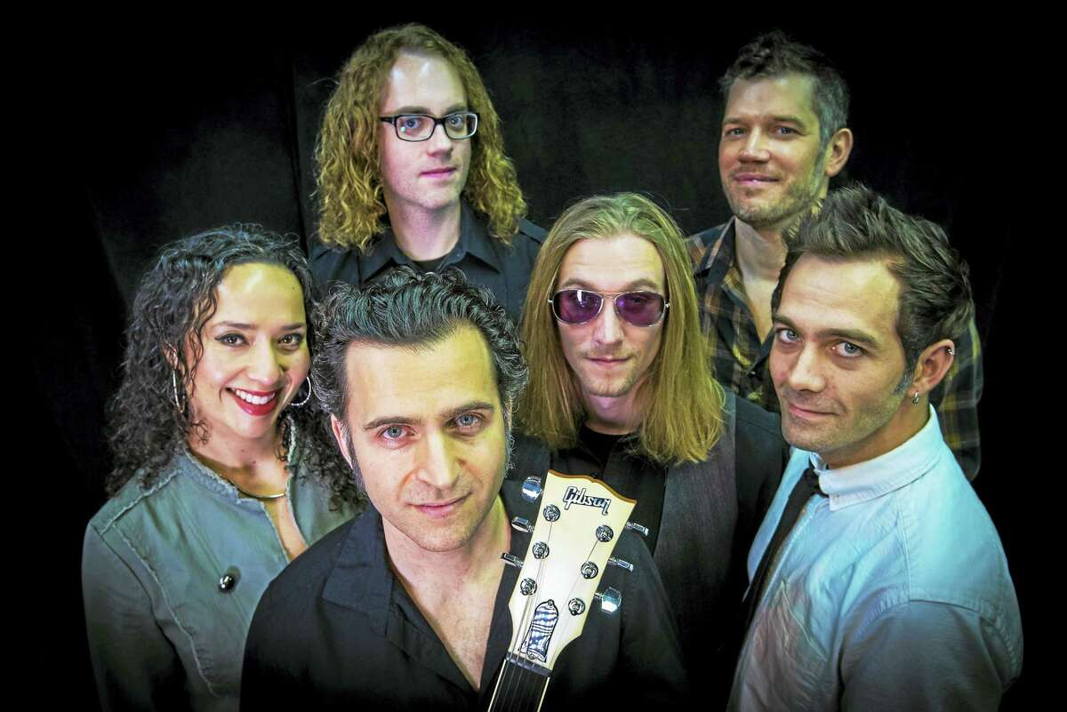 Dweezil Zappa, foreground, with his band.
