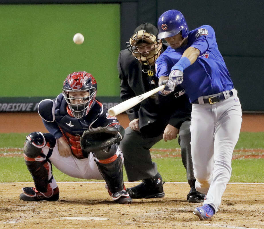 Chicago's Addison Russell hits a grand slam against the Cleveland Indians during the third inning of Game 6 of the World Series Tuesday in Cleveland. The Cubs won 9-3 to force Game 7 tonight. Photo: CHARLIE RIEDEL — THE ASSOCIATED PRESS   / Copyright 2016 The Associated Press. All rights reserved.