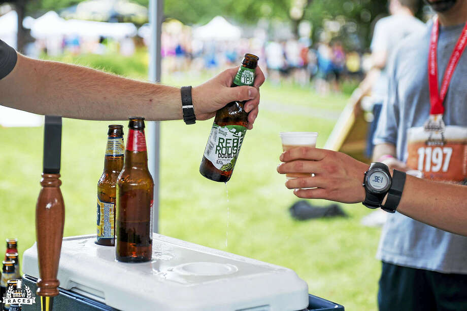 Participants can taste dozens of beers after the race. Photo: Photo Courtesy Of Jon Clancy — Craft Brew Races
