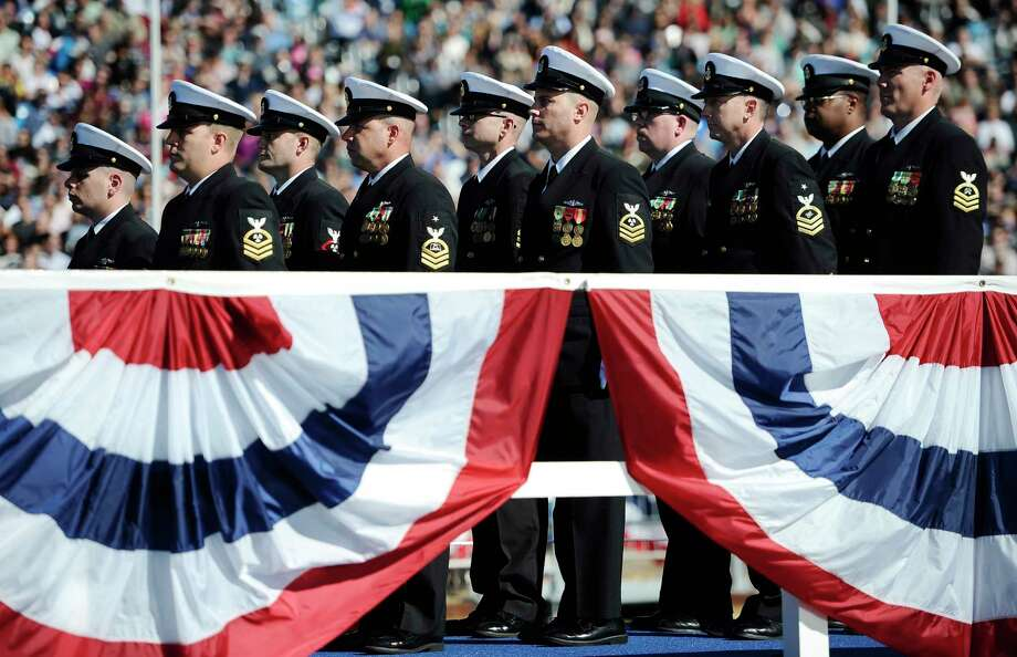 Crew of the USS Illinois stand atop their sub during christening ceremonies at Electric Boat, a division of General Dynamics, shipyard on Saturday, Oct. 10, 2015 in Groton, Conn. Photo: AP Photo/Jessica Hill   / AP2015
