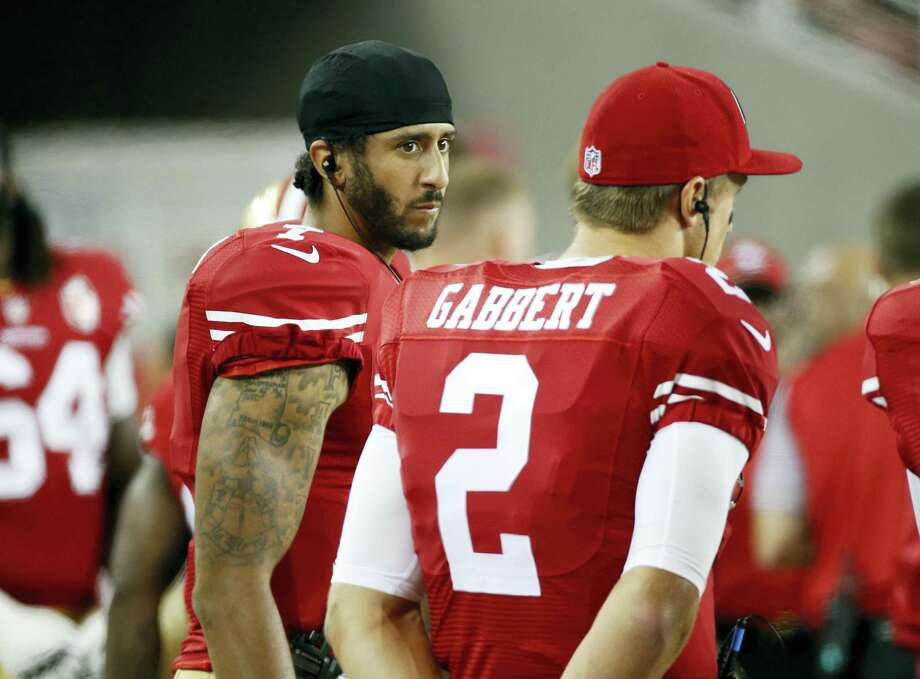 San Francisco 49ers quarterbacks Colin Kaepernick, left, and Blaine Gabbert stand on the sideline during the second half of an NFL preseason football game against the Green Bay Packers on Friday, Aug. 26, 2016, in Santa Clara, Calif. Green Bay won 21-10. Photo: AP Photo/Tony Avelar    / FR155217 AP