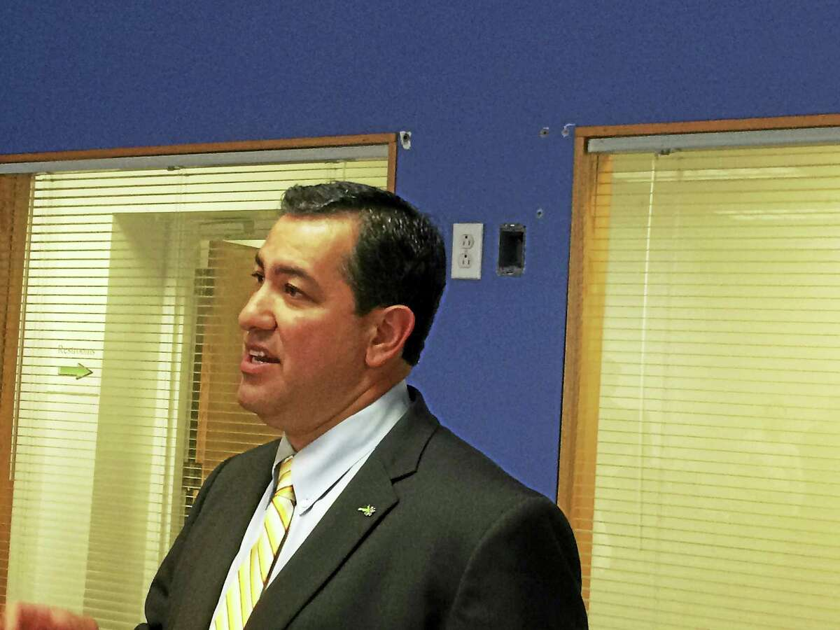 Bryan Garcia, president and chief executive officer of the ConnecticutGreen Bank, spoke Wednesday about the improvements the agency's C-PACEprogram has allowed the Meriden Enterprise Center to make, includingthe installation of a rooftop solar array.