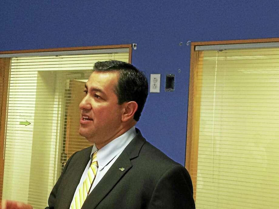 Bryan Garcia, president and chief executive officer of the ConnecticutGreen Bank, spoke Wednesday about the improvements the agency's C-PACEprogram has allowed the Meriden Enterprise Center to make,  includingthe installation of a rooftop solar array. Photo: Journal Register Co.