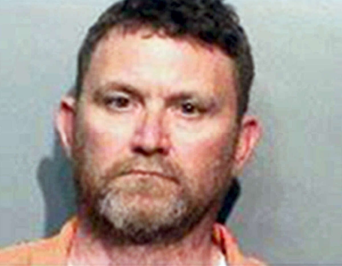 This undated photo provided by the Des Moines Police Department shows Scott Michael Greene, of Urbandale, Iowa. Des Moines and Urbandale Police said in a statement Wednesday, Nov. 2, 2016, that they have identified Greene as a suspect in the killings early Wednesday morning of two Des Moines area police officers. The two officers were shot to death in separate ambush-style attacks while they were sitting in their patrol cars.