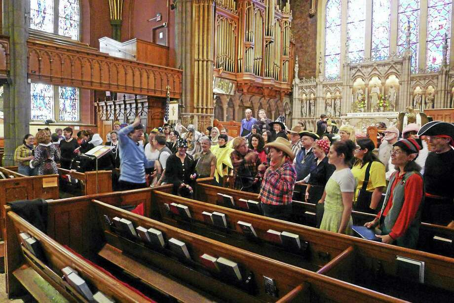 A rehearsal of the New Haven Chorale, with some in costume. Photo: Contributed