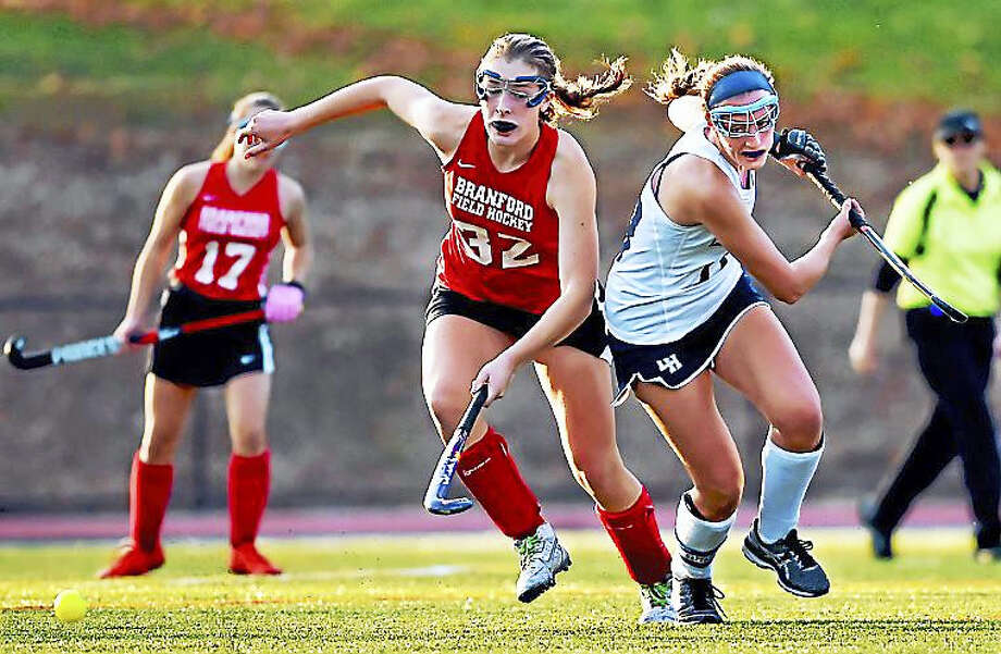 Branford midfielder Autumn McHenry and Lauralton Hall senior Madelyn Monahan battle for a loose ball Tuesday at the SCC semifinals in Milford. The Hornets won 4-1 in overtime. Photo: Catherine Avalone — New Haven Register