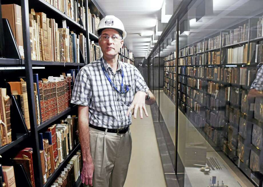 E.C. Schroeder, director of the Beinecke Rare Book and Manuscript Library at Yale University, is photographed on the sixth floor of the library in New Haven. Photo: Arnold Gold-New Haven Register