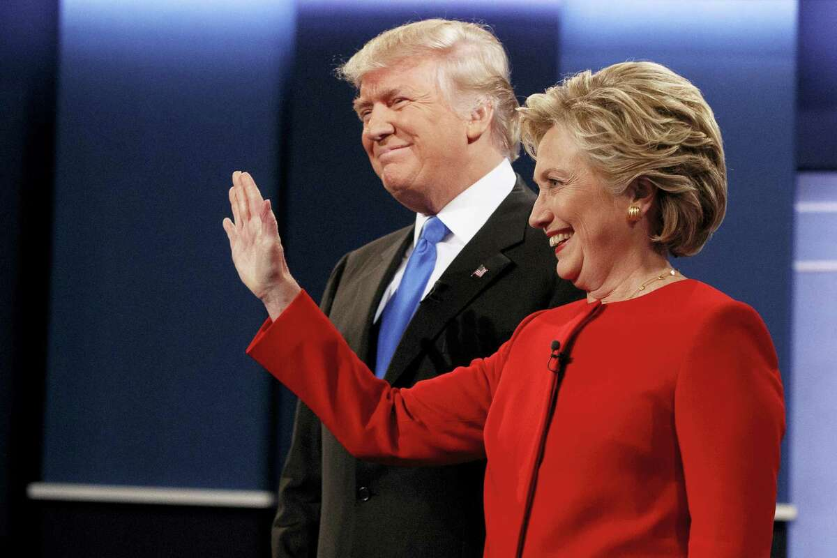 Republican presidential candidate Donald Trump, left, stands with Democratic presidential candidate Hillary Clinton before the first presidential debate at Hofstra University, Monday in Hempstead, N.Y.