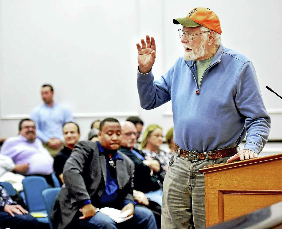 Dave Saldibar, 83, a life-long resident of West Haven turns to speak directly to the city's residents in March 2016, during the West Haven Redevelopment Agency's public hearing at city hall regarding the acquisition by purchase or eminent domain of the nine remaining properties involved in the Haven South Municipal Development Plan Project. Saldibar, a proponent of the project, doesn't agree the city of West Haven should use eminent domain for the remaining nine properties.
