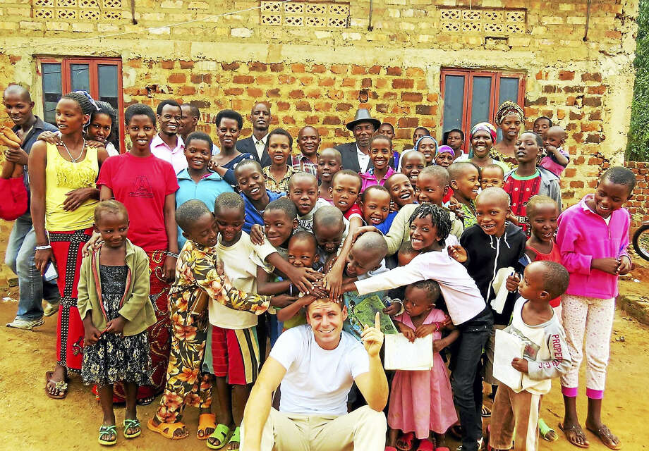 Photo courtesy of Kenny WynneSince May 2012, Branford resident, Kenny Wynne, 24, has been working toward giving Ugandan refugees a better life by providing them with permanent housing, schooling, medical supplies and resources. Photo: Journal Register Co.
