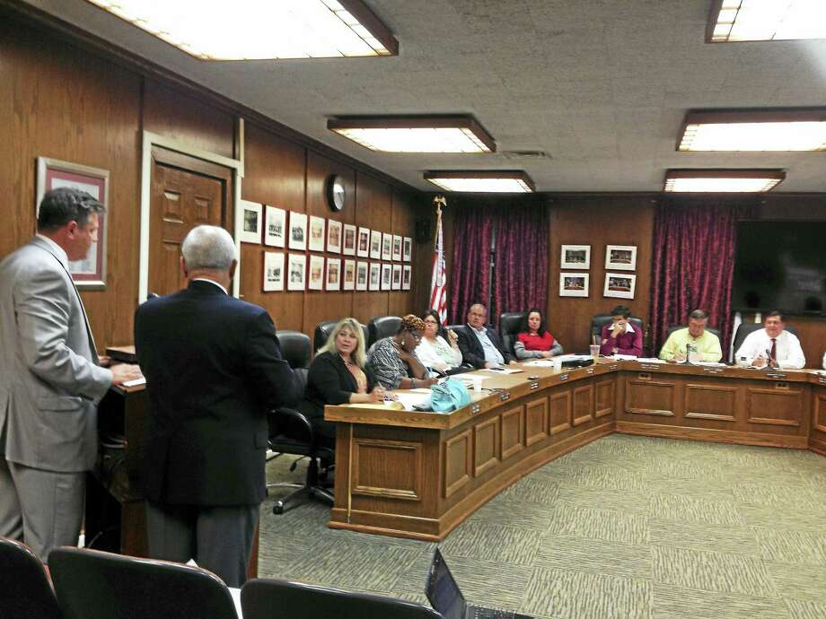West Haven Housing Authority Executive Director John Counter, left, and city Commissioner of Economic Development Joseph Riccio Jr. address the West Haven City Council Monday night regarding the proposed sale of the former Thompson School for $10. Photo: Mark Zaretsky - New Haven Register