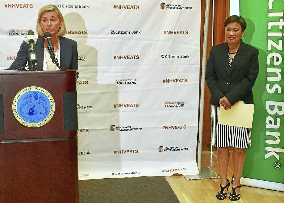 Anne Worcester, left, talks about New Haven Restaurant Week as Mayor Toni Harp looks on. Photo: Joe Amarante -- New Haven Register