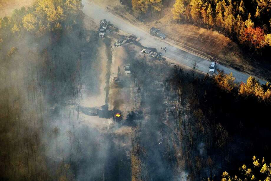 A flame continues to burn after a Monday explosion of a Colonial Pipeline on Nov. 1, 2016 in Helena, Ala. The blast, which sent flames and thick black smoke soaring over the forest, happened about a mile west of where the pipeline ruptured in September, Gov. Robert Bentley said in a statement. Photo: AP Photo/Brynn Anderson   / Copyright 2016 The Associated Press. All rights reserved.