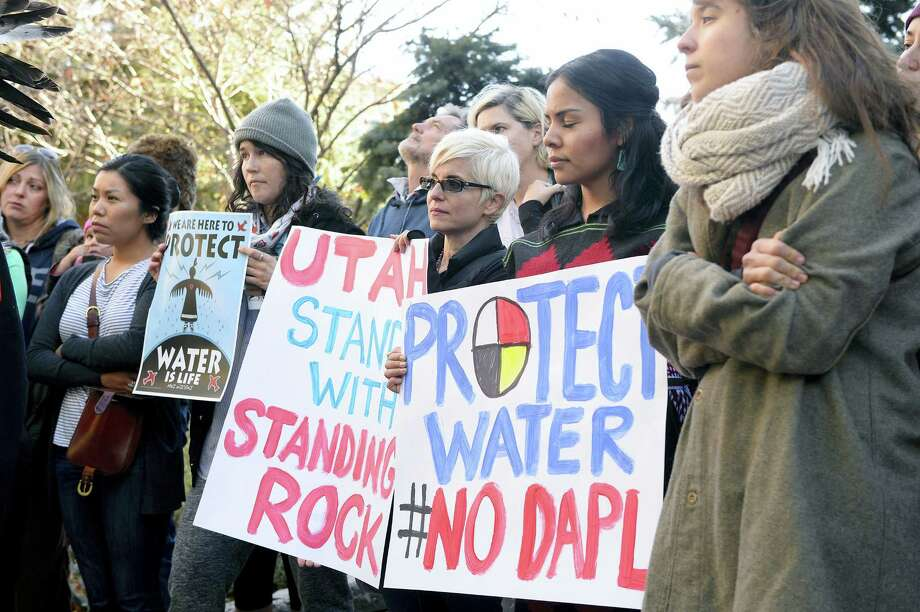 Protesters demonstrate in Salt Lake City in support of the Standing Rock Sioux against the Dakota Access Pipeline on Oct. 31, 2016. Following a rally at the Gallivan Center, the diverse group of over 100 marched half a block to the Wells Fargo Center building, where they held a protest in the lobby. Wells Fargo is one of several major banks financing the pipeline. Photo: Al Hartmann/The Salt Lake Tribune Via AP   / The Salt Lake Tribune