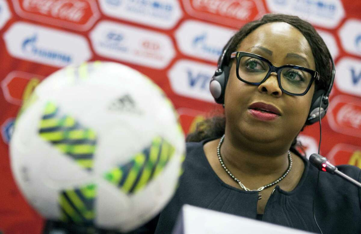 """This July 5, 2016 photo shows FIFA Secretary General Fatma Samoura as she speaks during a news conference in Moscow, Russia. Samoura insisted on Sept. 26, 2016 that the fight against racism is being taken """"very seriously"""" despite the governing body's task force overseeing discrimination being abolished."""