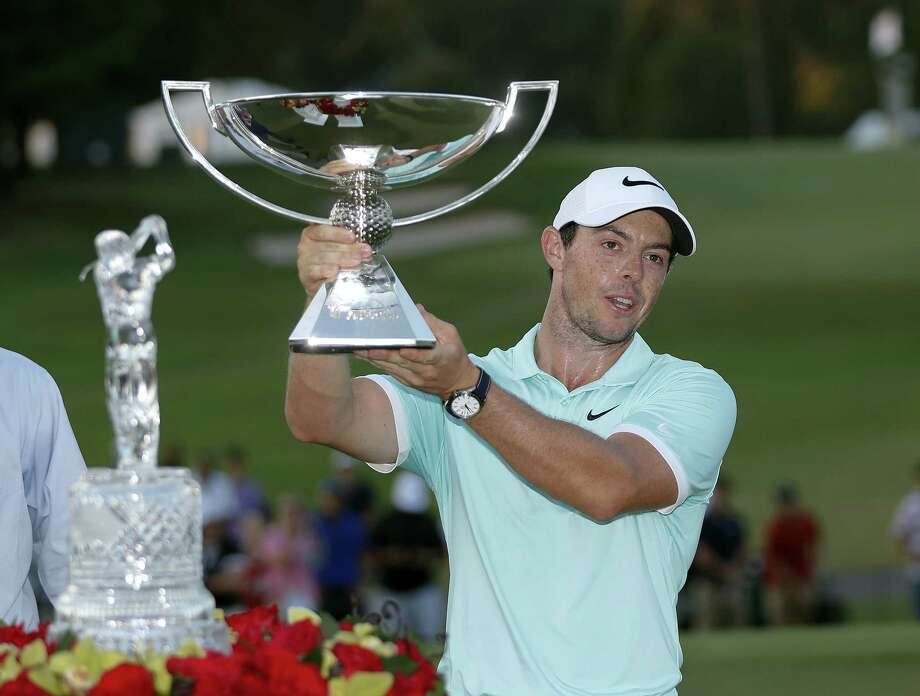 Rory McIlroy poses with the trophies after winning the Tour Championship golf tournament and FedEX Cup at East Lake Golf Club on Sept. 25, 2016 in Atlanta. Photo: AP Photo/John Bazemore   / AP