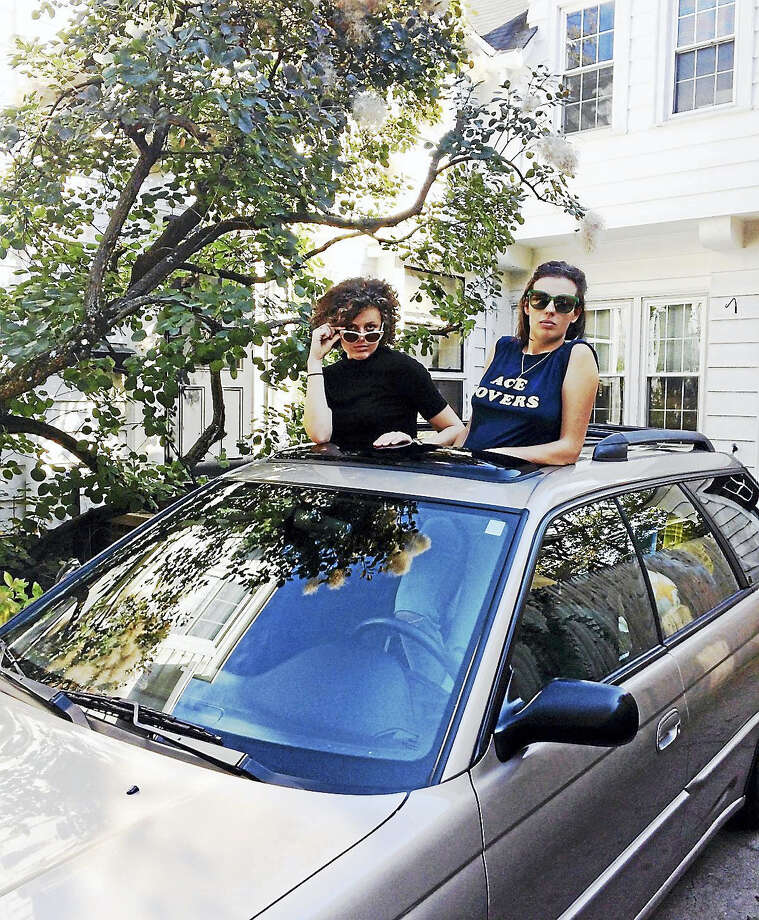 Charlotte Beach, left, and her sister, Natalie Beach, in their family's driveway in New Haven, moments before they hit the road on their cross-country trip. Photo: Photo By Jennifer Kaylin