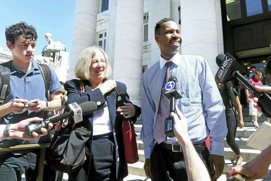 Corey Menafee, right, leaves Superior Court in New Haven accompanied by his attorney, Patricia Kane, Tuesday. Photo: Arnold Gold — New Haven Register
