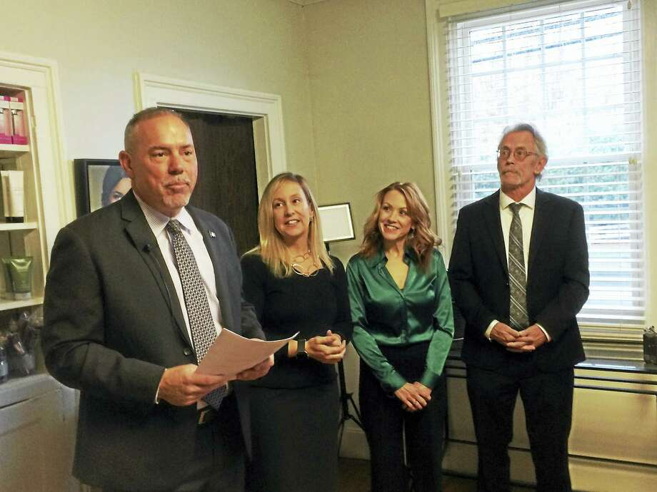 State House Majority Leader Joe Aresimowicz, far left, discusses the House Democrats' plans to improve the state's small-business environment Thursday in Cheshire. Looking on, from left, are Liz Linehan, candidate for the 103rd District House seat; small business owner Dana Bartone-Nastri; and Patrick Reynolds, Democratic candidate for the 90th District seat. Photo: LUTHER TURMELLE — NEW HAVEN REGISTER