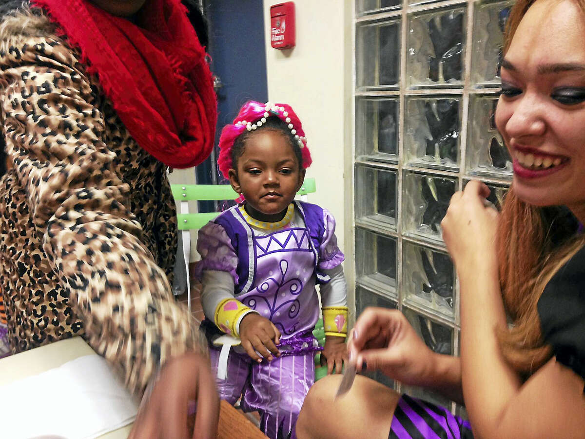 New Haven police hosted families in Westville for a Halloween night at the District 2 substation. Students from Southern Connecticut State University volunteered to dress in costumes, face paint, tattoo, and give candy to the kids.