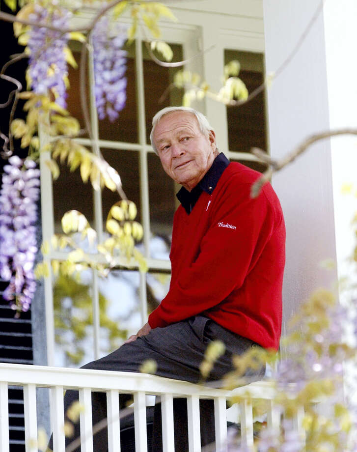 This 2004 file photo shows former Masters champion Arnold Palmer as he sits on clubhouse railing at the Augusta National Golf Club in Augusta, Ga. Photo: David J. Phillip — The Associated Press File   / Copyright 2016 The Associated Press. All rights reserved.
