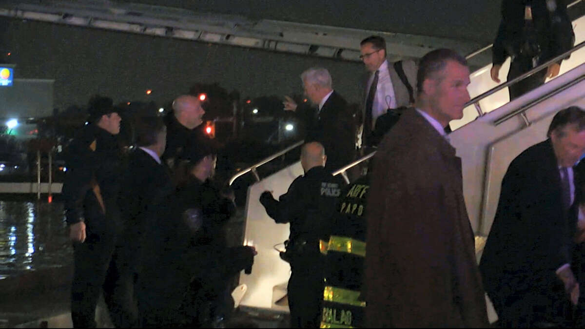 Republican presidential candidate Indiana Gov. Mike Pence walks down the steps of his campaign plane at New York's LaGuardia Airport after it slide off the runway while landing on Thursday, Oct. 27, 2016.