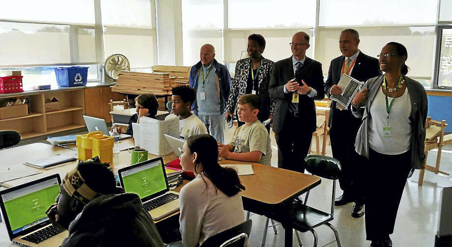 State Sen. Joseph Crisco, Rep. Robyn Porter, Hamden Middle School Principal Dan Levy, state Rep. Joe Aresimowicz and Rep. Toni Walker during a class at Hamden Middle School Wednesday. Photo: Kate Ramunni — New Haven Register
