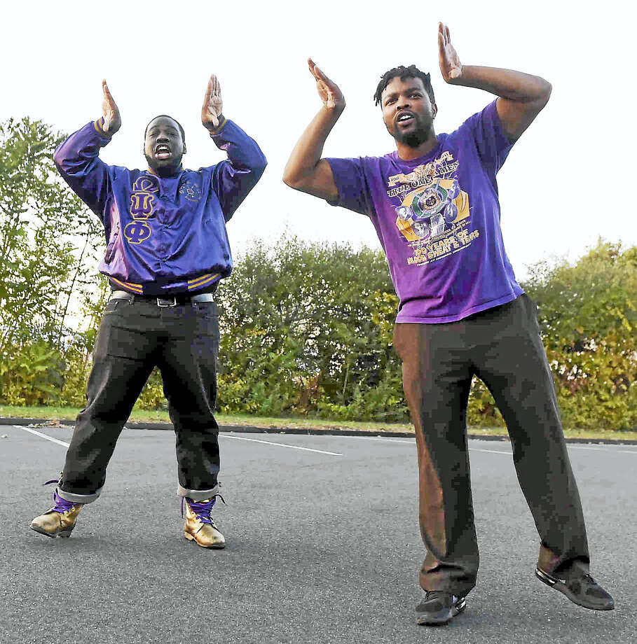 "Avery Washington, left, and Malcolm Welfare of the New Haven Chi Omicron chapter of the Omega Psi Phi Fraternity Inc., do a ""Get Out The Vote"" hop and chant dance for the Nov. 8, election encouraging the New Haven community to vote. Photo: Peter Hvizdak - New Haven Register   / ©2016 Peter Hvizdak"