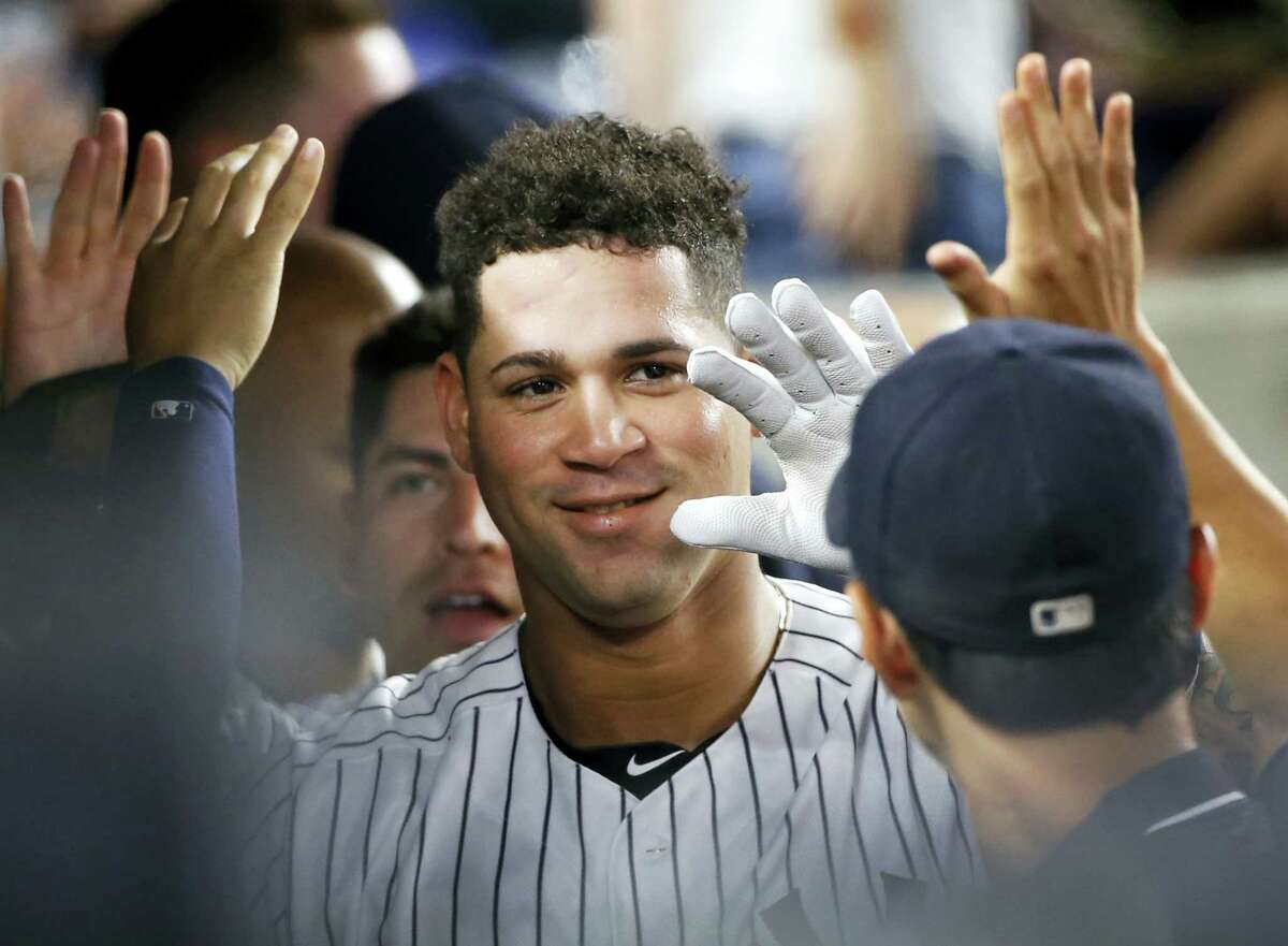 Teammates celebrate with Gary Sanchez, center, after Sanchez hit a fifth-inning, two-run home run, on Friday.