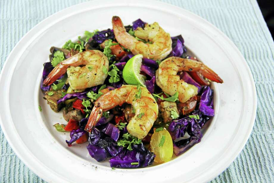 Grilled shrimp and vegetable salad with Asian dressing adds a kiss of summer by tossing the veggies on the barbecue. Photo: Melissa D'Arabian — The Associated Press   / AP