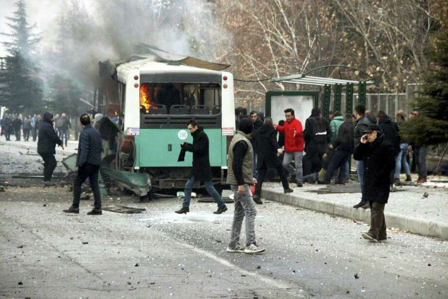 A public bus is burning at the scene of a car bomb attack in central Anatolian city of Kayseri, Turkey, Saturday, Dec. 17, 2016. A public bus was heavily damaged and dear and injured were reported. Turkish authorities have banned distribution of images relating to the Istanbul explosions within Turkey. Photo: IHA Via AP / IHA