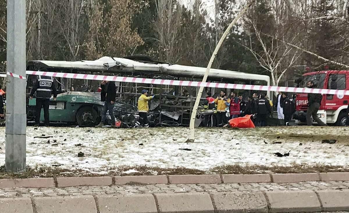 Rescue services members work at the scene of a car bomb attack in central Anatolian city of Kayseri, Turkey, Saturday, Dec. 17, 2016. A public bus was heavily damaged and dear and injured were reported. Turkish authorities have banned distribution of images relating to the Istanbul explosions within Turkey.